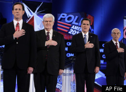 Republican presidential candidates, from left, former Pennsylvania Sen. Rick Santorum, former House Speaker Newt Gingrich, former Massachusetts Gov. Mitt Romney and Rep. Ron Paul, R-Texas, stand during the National Anthem at the Republican presidential candidates debate at the University of North Florida in Jacksonville, Fla., Thursday, Jan. 26, 2012. (AP Photo/Paul Sancya)