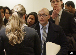 In this Jan. 25, 2012 photo, job seekers attend a job fair held by JobEXPO, a company hosting hiring events, in New York.