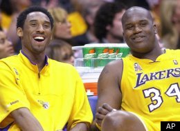 Los Angeles Lakers' Kobe Bryant, left, and teammate Shaquille O'Neal laugh as they watch the end of their game against the Sacramento Kings from the bench, Wednesday night, April 17, 2002, in Los Angeles. The Lakers won 109-95. Let's sum up the NBA playoffs with a five-word question: Can anybody beat the Lakers? (AP Photo/Mark J. Terrill)