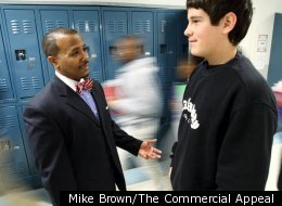 Millington Middle School principal Dr. Michael Lowe talks to one of his students in the hallway between classes. Lowe and both of his vice-principals evaluate each teacher and then combine the score.