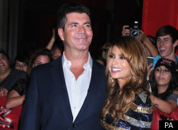 Simon Cowell has revealed he fought for Paula Abdul to keep her seat on 'US X Factor'