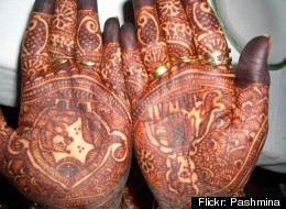 In India, it's a wedding tradition for the bride to have mehndi designs, or henna tattoos, on her hands for the ceremony.