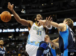 Denver Nuggets forward Nene, left, of Brazil, loses the ball while trying to drive against Dallas Mavericks forward Dirk Nowitzki, of Germany, in the second half of an NBA basketball game in Denver on Wednesday, Feb. 8, 2012. The Mavericks won 105-95. (AP Photo/Chris Schneider)