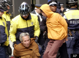 Police remove demonstrators who tried to block the entrance to the federal building during an anti-war protest Friday, March 21, 2003, in Chicago. (AP Photo/Stephen J. Carrera)