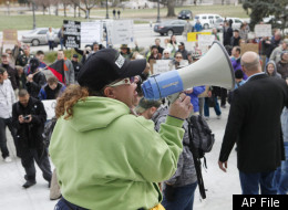 A woman uses a megaphone to address Occupy Denver protesters at the City and County Building in Denver, on Thursday, Nov. 17, 2011. (AP Photo/Ed Andrieski)