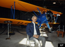 Former Tuskegee Airman Herbert Carter, 94, of Tuskegee, Ala., poses with a PT-17 trainer aircraft in a hangar at Tuskegee Airmen National Historic Site at Moton Field in Tuskegee, Ala., Wednesday, Jan. 18, 2012.
