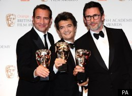 Jean Dujardin, Thomas Langmann and Michel Hazanavicius with their awards for the Artist