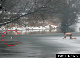 A man stripped off to his underwear to rescue his dog from the frozen lake