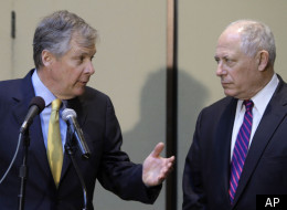 Illinois Gov. Pat Quinn, right, and Caterpillar CEO Doug Oberhelman, left, discuss Illinois' business climate and taxes during a news conference Tuesday, April 5, 2011, in Peoria, Ill. (AP Photo/Seth Perlman)
