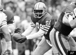 FILE - In this Jan. 6, 1985, file photo, San Francisco 49ers wide receiver Freddie Solomon (88) prepares for a handoff after lining up at quarterback during the NFL football NFC championship game against the Chicago Bears in San Francisco. Solomon, the former Miami Dolphins and 49ers wide receiver who became known as
