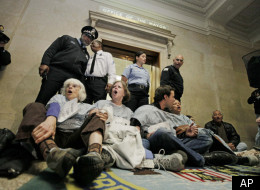 Activists protest mental health facility closures inside Chicago's City Hall last fall.