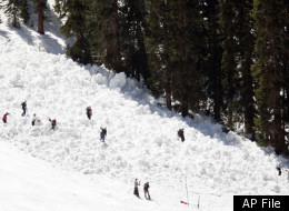Members of the Summit County Rescue Group search the slide area on the Pallavicini trail at Arapahoe Basin Ski Area, Friday, May 20, 2005 in Breckenridge, Colo., after an avalanche killed a 54-year-old Colorado man, officials said. Authorities said they did not believe anyone else was missing in the snowslide, but a search was suspended because of ``continuing extreme avalanche danger'' as the afternoon temperature rose. (AP Photo/Chris Doane)