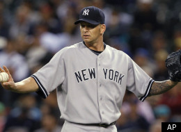 New York Yankees starting pitcher A.J. Burnett calls for time to get a new ball after giving up a hit to the Seattle Mariners in the first inning of a baseball game Tuesday, Sept. 13, 2011, in Seattle. (AP Photo/Elaine Thompson)
