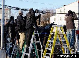 Les médias se massent à Newark, alors que le corps de Whitney Houston a quitté le salon funéraire pour se dirgier vers l'église de Newark. (AFP)