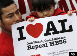 Opponents of Alabama's immigration law outside the Statehouse in Montgomery, Ala., on Feb. 14  was calling for the repeal of HB56. (AP Photo/Dave Martin)