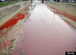 Blood red river: The river, which divides the east and western suburbs of Beirut turned an eerie shade of red last week