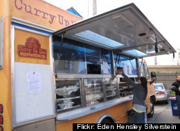 A hungry patron orders from the popular Curry Up Now food truck in San Francisco.