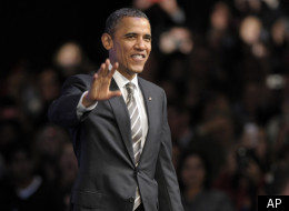 President Barack Obama walks onto the stage to speak at the Nob Hill Masonic Center in San Francisco, Thursday, Feb. 16, 2012.