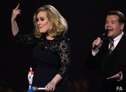 Adele flips the bird at the Brits 2012