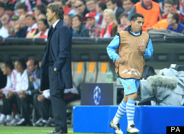 Walk on by: Carlos Tevez jogs past Roberto Mancini during that infamous night at the Allianz Arena