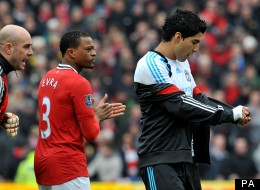 Patrice Evra goes to confront Luis Suarez after the Uruguayan refused to shake his hand prior to Manchester United's clash with Liverpool