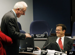 State Rep. John Kavanagh, left, speaks with fellow Republican Rep. Tom Forese prior to budget hearings in the committee in March 2011. Kavanagh was the sponsor of the minimum tuition bill. In the past he sponsored a bill to challenge automatic citizenship guaranteed under the the 14th Amendment. (AP Photo/Ross D. Franklin)