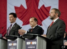 Paul Dewar, Brian Topp and Thomas Mulcair at the NDP leadership debate in Ottawa on Dec. 4, 2011. (CP)