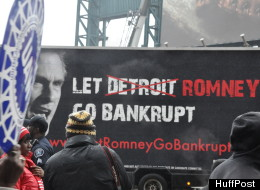 Around 250 auto workers and supporters marched in Detroit Friday, Feb. 24, 2012 in advance of Presidential candidate Mitt Romney's speech on tax policy at Ford Field.