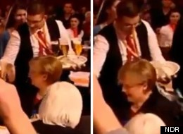 Something cold and wet: The German Chancellor is drenched