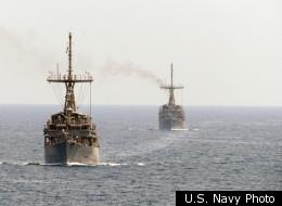 Mine Hunters USS Scout and USS Gladiator (rear) Patrol the Strait of Hormuz.