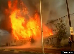 A forest fire in Viña del Mar, Chile, has engulfed and burned through 73 homes already. (Reuters)