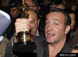 Jean Dujardin returns to France with his Oscar for The Artist