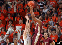 Florida State guard Ian Miller (30) shoots over Virginia guard Sammy Zeglinski (13) in the final seconds of an NCAA college basketball game Thursday, March 1, 2012, in Charlottesville, Va. Florida State defeated Virginia 63-60. (AP Photo/Andrew Shurtleff)