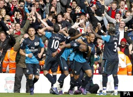 Robin van Persie celebrates his Anfield winner along with Arsenal supporters and team-mates