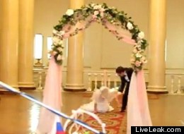 Bride falls over as she walks up the aisle