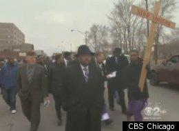 Pfleger and dozens of parishioners march through Auburn Gresham.