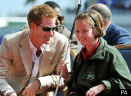 Prince Harry talks to blind girl Anna Albury 12, in the National Athletics Stadium in Nassau
