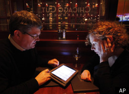 In this photo taken Wednesday, Dec. 1, 2010, Keith Peg Bragg of Chicago view the wine list on an iPad at Chicago Cut steakhouse in Chicago. The restaurant is just one eatery of several across the U.S. that have started uploading menus and wine lists to the digital devices. (AP)