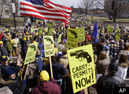 Gun owners rally at the Illinois State Capitol in Springfield, Ill., Wednesday, March 11, 2009, to seek legislation that would let them carry concealed weapons.