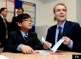 Expert Adviser on Behaviour Charlie Taylor studies a pupils work