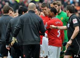 Luis Suarez refuses to shake Patrice Evra's hand, but Johnson suggests otherwise