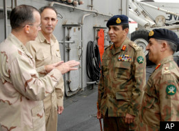 In this Aug. 27, 2008 file photo released by the U.S. Department of Defense, Chairman of Joint Chiefs of Staff, Pakistan's Gen. Ahmed Shuja Pasha, right, is seen on the flight deck aboard USS Abraham Lincoln, in the Persian Gulf with, from left, Adm. Mike Mullen and Navy Rear Adm. Scott van Buskirk, and Pakistani Chief of Army Staff, Gen. Ashfaq Kayani. (AP)