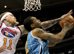 Denver Nuggets center Chris Andersen (11) fouls New Orleans Hornets forward Lance Thomas (42) during the second quarter of an NBA basketball game Friday, March 9, 2012 in Denver. (AP Photo/Barry Gutierrez)