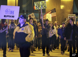 Occupy Chicago protesters march in Chicago downtown, Wednesday, Nov. 2, 2011. (AP Photo/Nam Y. Huh)