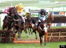 Cinders and Ashes, ridden by jockey Jason Maguire (right), wins the William Hill Supreme Novices' Hurdle on Centenary Day