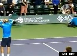 Rafael Nadal checks on a fallen fan.