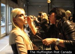 A model gets ready for Rudsak during Toronto Fashion Week 2012.