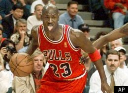 Chicago Bulls Michael Jordan (23) moves up court with Miami Heat's Keith Askins (2) in pursuit during first half NBA action in Miami Wednesday, April 16, 1997. (AP Photo/Hans Deryk)