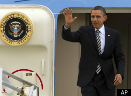 President Barack Obama arrives at Los Angeles International Airport in Los Angeles, Wednesday, Feb. 15, 2012. (AP Photo/Damian Dovarganes)