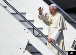 Pope Benedict XVI waves as he boards a plane on his way to a six-day visit to Mexico and Cuba, at Rome's Fiumicino international airport, Friday, March 23, 2012. (AP)